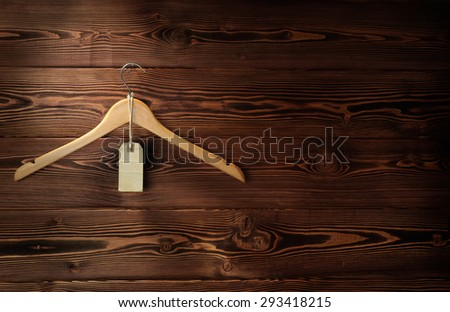The wooden hanger hangs on a wooden wall - stock photo