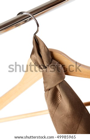 the wooden hanger on white background