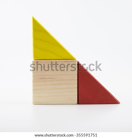 The wooden house. Children's toys - wooden cubes on a white background