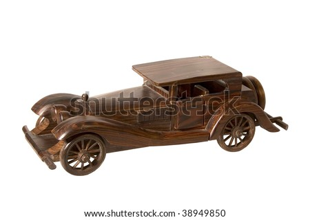 The wooden model of the retrocar executed from an integral piece of a dark tree and covered with a varnish