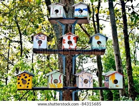 The Wooden of birdhouse family on tree - stock photo