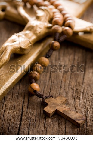 the Wooden rosary beads and crucifix - stock photo