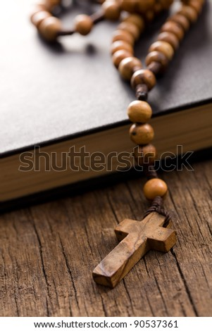 the Wooden rosary beads and holy bible - stock photo