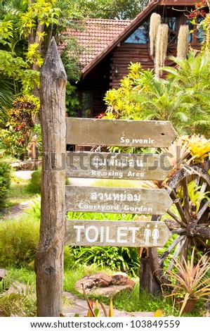 The wooden Route signage and points to the right way. - stock photo