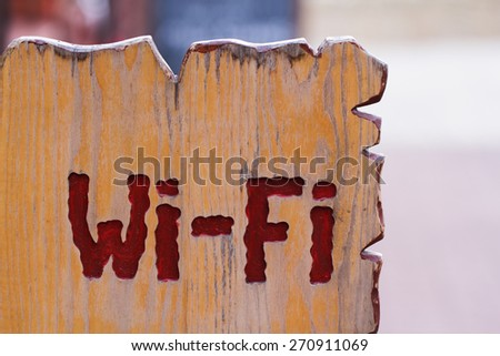 The wooden sign with Wi Fi text on it - stock photo