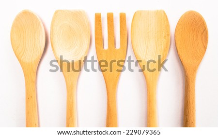 The wooden spoon isolated on white background - stock photo