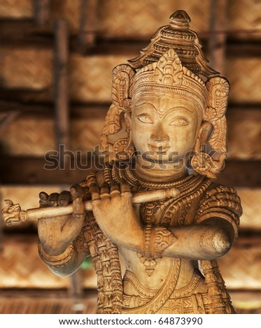The wooden statue of God Krishna - stock photo