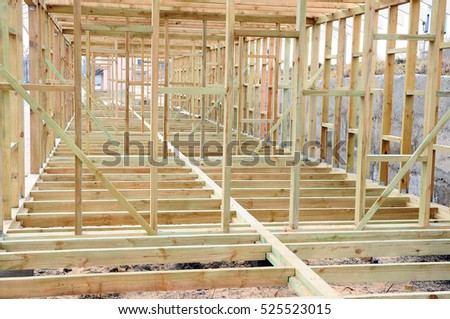 The wooden structure of the building. Wooden frame building. Connection and fastening of beams in the construction of buildings