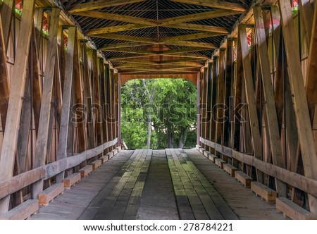 The wooden trusses of the James Covered Bridge are seen from within. The historic bridge crosses Big Graham Creek in rural Jennings County, Indiana. - stock photo
