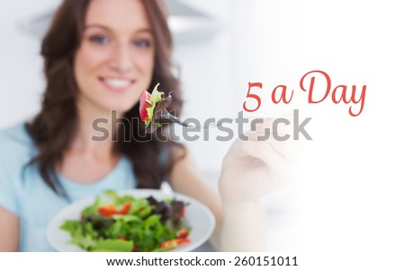 The word 5 a day against brunette offering healthy salad - stock photo