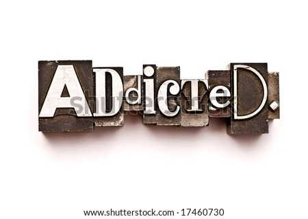 The word Addicted photographed using vintage letterpress type