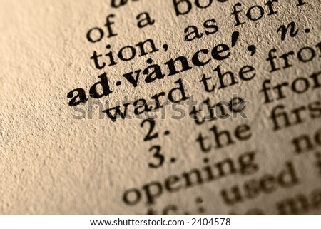 The word advance. Close-up of the word advance in a dictionary. - stock photo