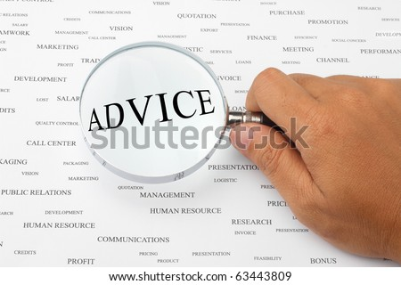 The word ADVICE is magnified. - stock photo