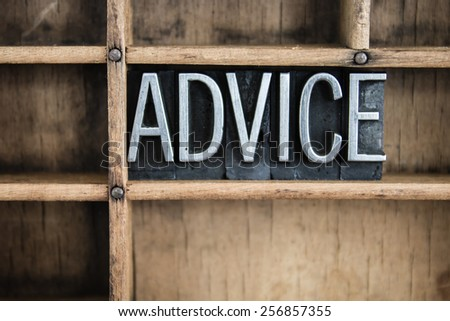 "The word ""ADVICE"" written in vintage metal letterpress type in a wooden drawer with dividers. - stock photo"