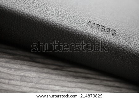"The word ""Airbag"" is written on a car's dashboard. - stock photo"