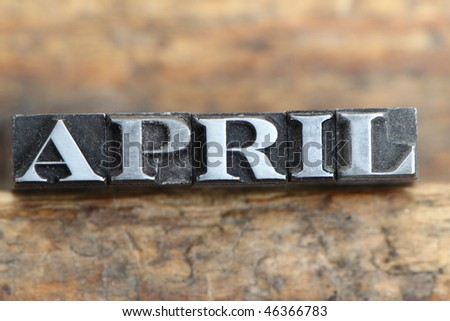 the word april in letterpress type on a wooden background. - stock photo
