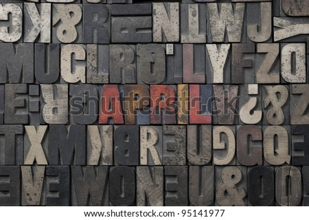 The word April written in antique letterpress printing blocks. - stock photo