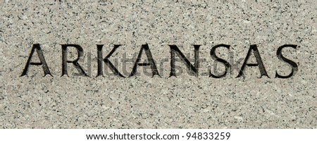 "The word ""Arkansas"" carved into granite"