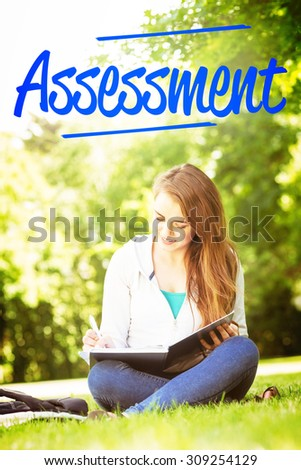 The word assessment against smiling university student sitting and writing on notepad - stock photo