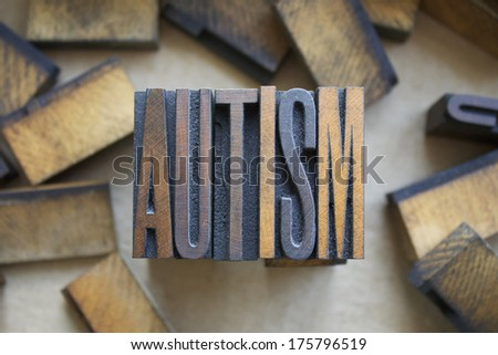 The word AUTISM written in vintage wood letterpress type - stock photo