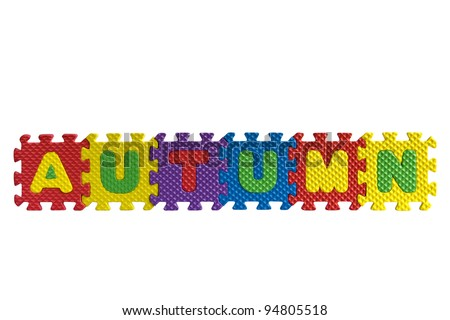 "The word ""Autumn"" written with alphabet puzzle letters isolated on white background"