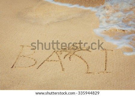 "the word "" Bali "" on the beach"
