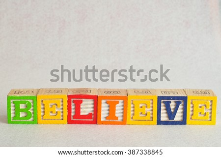 The word believe spelled with colorful alphabet blocks isolated against a white background