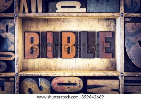 "The word ""Bible"" written in vintage wooden letterpress type. - stock photo"