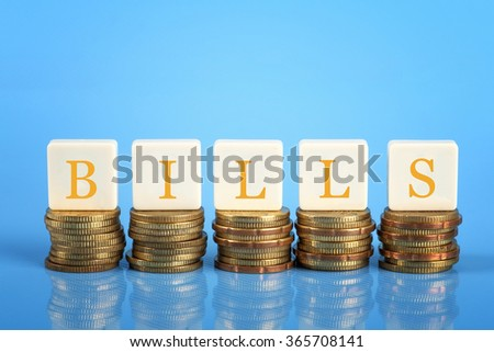The word Bills on stacked coins, finance conceptual