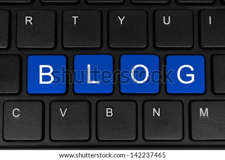 The word blog made of four blue buttons of a black keyboard close-up - stock photo
