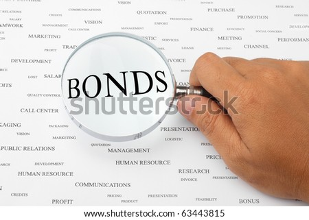 The word BONDS is magnified. - stock photo