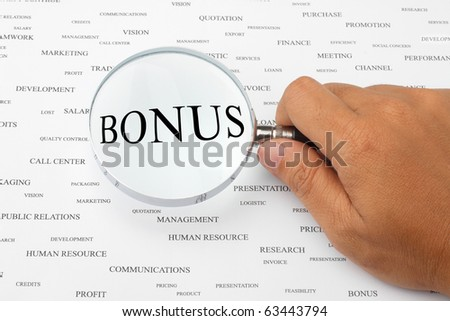 The word BONUS is magnified. - stock photo