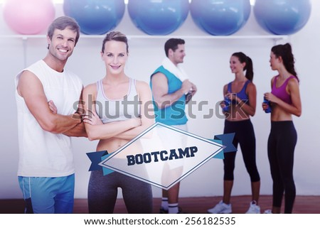 The word bootcamp and smiling couple with fitness class in background against badge - stock photo