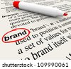 The word Brand defined in a dictionary with definition explained to emphasize awareness, branding, loyalty, identity and value - stock photo