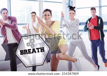 The word breath and cheerful fitness class and instructor doing pilates exercise against hexagon - stock photo