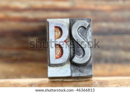 the word bs in letterpress type on a wooden background. - stock photo