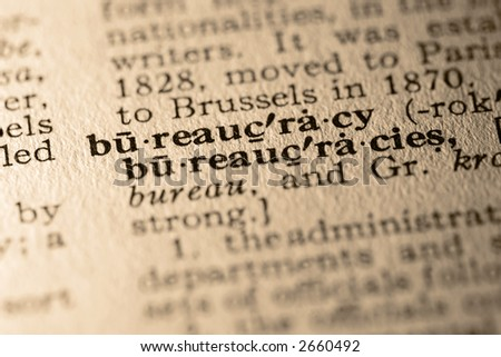 The word bureaucracy. Close-up of the word bureaucracy in a dictionary. - stock photo
