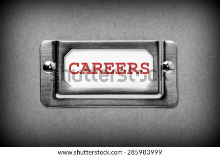 The word Careers in red text on a white card in a storage drawer label holder on a box, processed in black and white for effect