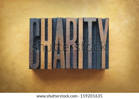 The word CHARITY written in vintage letterpress type. - stock photo