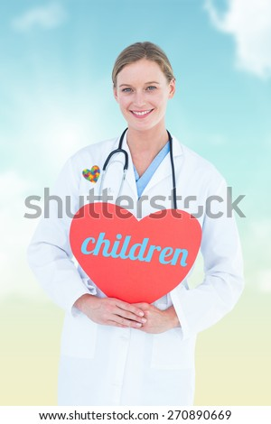 The word children and doctor holding red heart card against blue sky - stock photo