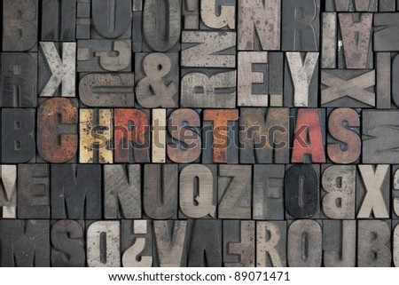 The word Christmas written in very old letterpress type - stock photo