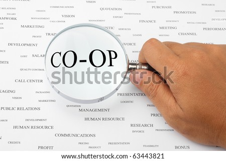 The word CO-OP is magnified. - stock photo