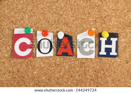 The word Coach in cut out magazine letters pinned to a cork notice board. To coach has been borrowed from sports by business to cover motivation and training for employees.
