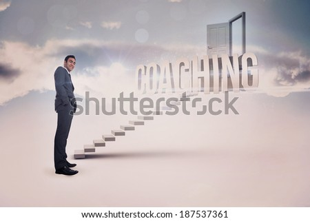 The word coaching and smiling businessman standing against white steps leading to open door - stock photo