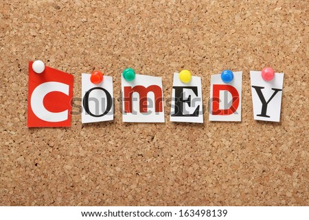 The word Comedy in cut out magazine letters pinned to a cork notice board