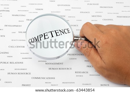 The word COMPETENCE is magnified. - stock photo