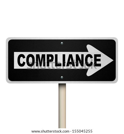 The word Compliance on a street sign pointing the way to complying with rules, guidelines, regulations and laws for your business or life - stock photo