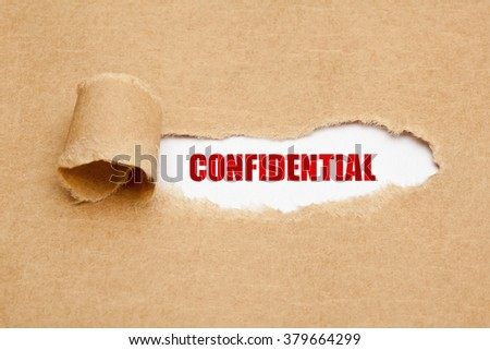 The word Confidential appearing behind torn brown paper.