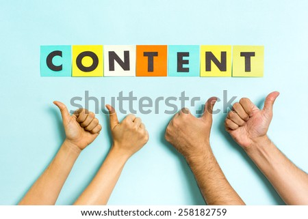 "The word ""content"" with four hands making thumbs up gesture. Content marketing concept. - stock photo"