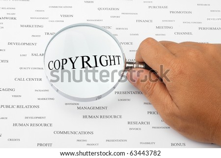 The word COPYRIGHT is magnified. - stock photo
